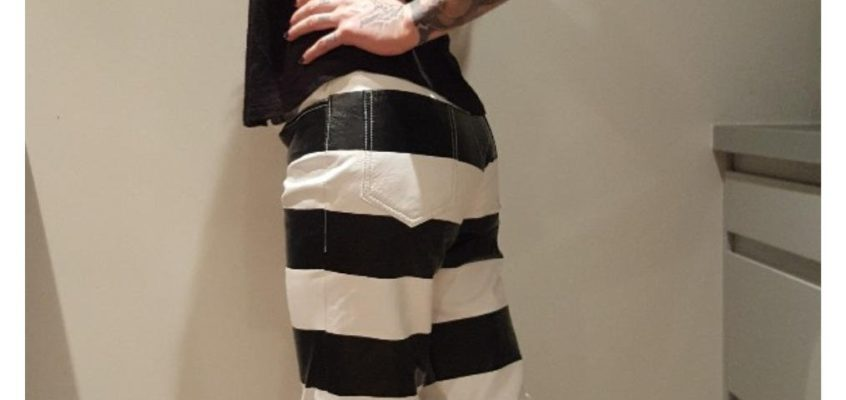 woman-motorcycle-leather-trouser-prisoner-striped-jail-hold-fast-back